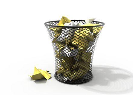 a mesh trashcan with yellow objects in it