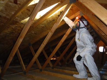 individual in a hazmat suit in an attic