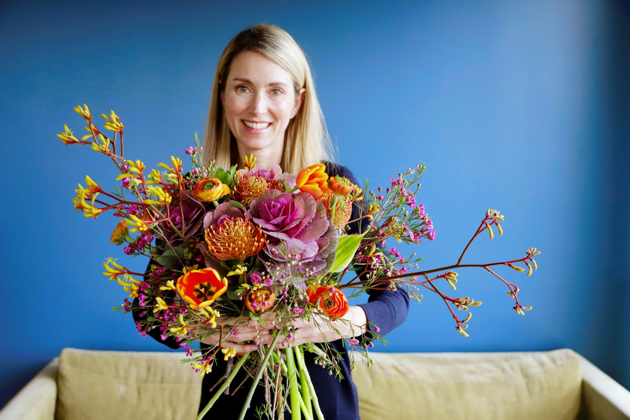 Liz of FiftyFlowers holding a bouquet