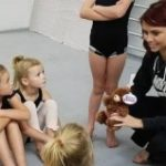Dance instructor with students